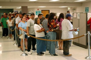 Unemployed workers line up at a state office in California (public domain photo via FEMA)