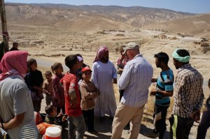 Yazidi refugees and American aid workers on Mount Sinjar in August 2014 (public domain image via USAID)